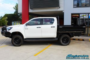 """Left side view of a White Toyota Revo Hilux Dual Cab after fitment of a Superior 4"""" Inch Lift Kit"""
