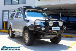 """Right front side view of a Toyota Vigo Hilux Dual Cab after fitment of a Superior Remote Reservoir 2"""" Inch Lift Kit with King Coil Springs"""