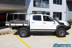"""Right side view of a Toyota Vigo Hilux Dual Cab before fitment of a Superior Remote Reservoir 3"""" Inch Lift Kit with King Coil Springs"""