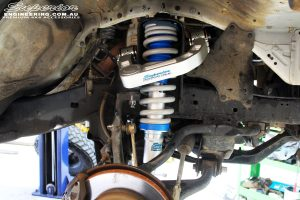 """Front left inside guard view of the fitted front Superior 3"""" Adjustable Monotube Remote Reservoir Strut + Coil Spring & Superior Billet Alloy Upper Control Arms"""