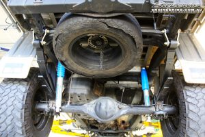 """Rear mid underbody shot of the fitted Superior 3"""" Adjustable Monotube Remote Reservoir Shocks, Leaf Springs + Greasable Shackles with U-Bolt Kit"""