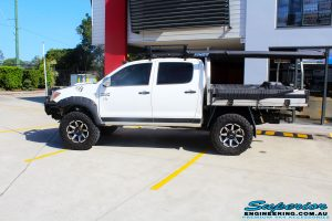 """Left side view of a Toyota Vigo Hilux Dual Cab after fitment of a Superior Remote Reservoir 3"""" Inch Lift Kit with King Coil Springs & Superior Billet Alloy Upper Control Arms"""