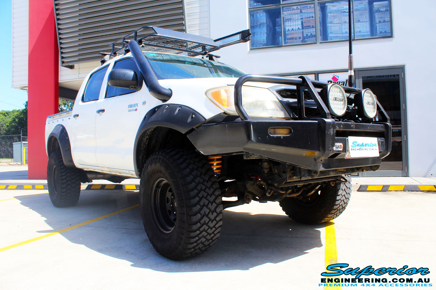 "Right front side view of a Toyota Vigo Hilux Dual Cab after fitment of a Superior Remote Reservoir 3"" Inch Lift Kit with King Coil Springs & Superior Billet Alloy Upper Control Arms"