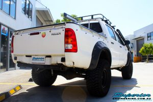 """Rear right view of a Toyota Vigo Hilux Dual Cab after fitment of a Superior Remote Reservoir 3"""" Inch Lift Kit with King Coil Springs & Superior Billet Alloy Upper Control Arms"""