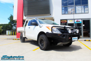 """Right front side view of a Mazda BT50 in White before fitment of a Superior 3"""" Inch Remote Reservoir Lift Kit with Nitto Terra Grappler Tyres + ROH Black Steel Wheels"""