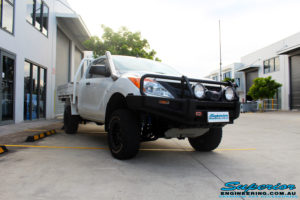 """Right front side view of a Mazda BT50 in White after fitment of a Superior 3"""" Inch Remote Reservoir Lift Kit with Nitto Terra Grappler Tyres + ROH Black Steel Wheels"""