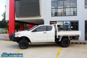 """Left side view of a Mazda BT50 in White after fitment of a Superior 3"""" Inch Remote Reservoir Lift Kit with Nitto Terra Grappler Tyres + ROH Black Steel Wheels"""