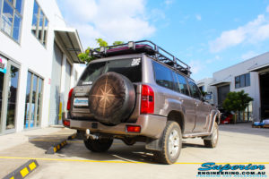 """Rear right side view of a Brown Nissan GU Patrol Wagon before fitment of a Superior Nitro Gas 2"""" Inch Lift Kit, Front & Rear Adjustable Panhard Rods, Coil Tower Brace Kit, Superior Hybrid Radius Arms, Superior Comp Spec Tie Rod and Superior Solid Bar Comp Spec Adjustable Drag Link"""