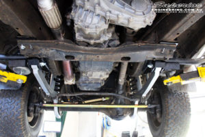 Front mid underbody shot looking forward on the fitted Superior Hybrid Radius Arms and Superior Comp Spec Tie Rod