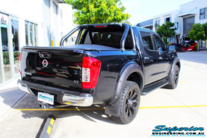 "Rear right view of a Nissan NP300 Navara Dual Cab before fitment of a Superior Nitro Gas 2"" Inch Lift Kit with King Coil Springs"