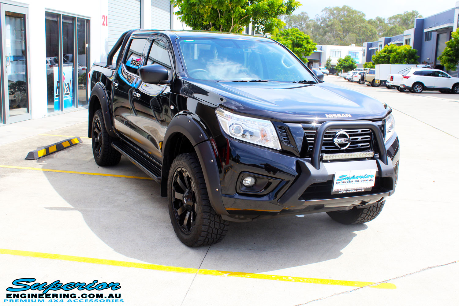 "Right front side view of a Nissan NP300 Navara Dual Cab after fitment of a Superior Nitro Gas 2"" Inch Lift Kit with King Coil Springs"