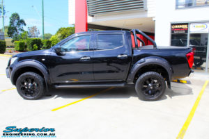 """Left side view of a Nissan NP300 Navara Dual Cab after fitment of a Superior Nitro Gas 2"""" Inch Lift Kit with King Coil Springs"""