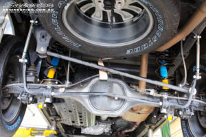 """Rear mid underbody shot looking forward of the fitted 2"""" Bilstein Rear Shocks with Coil Springs & Superior Sway Bar Extensions"""