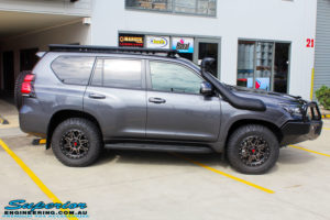 """Right side view of a Toyota 150 Landcruiser Prado in Grey before fitment of a 2"""" Inch Lift Kit"""