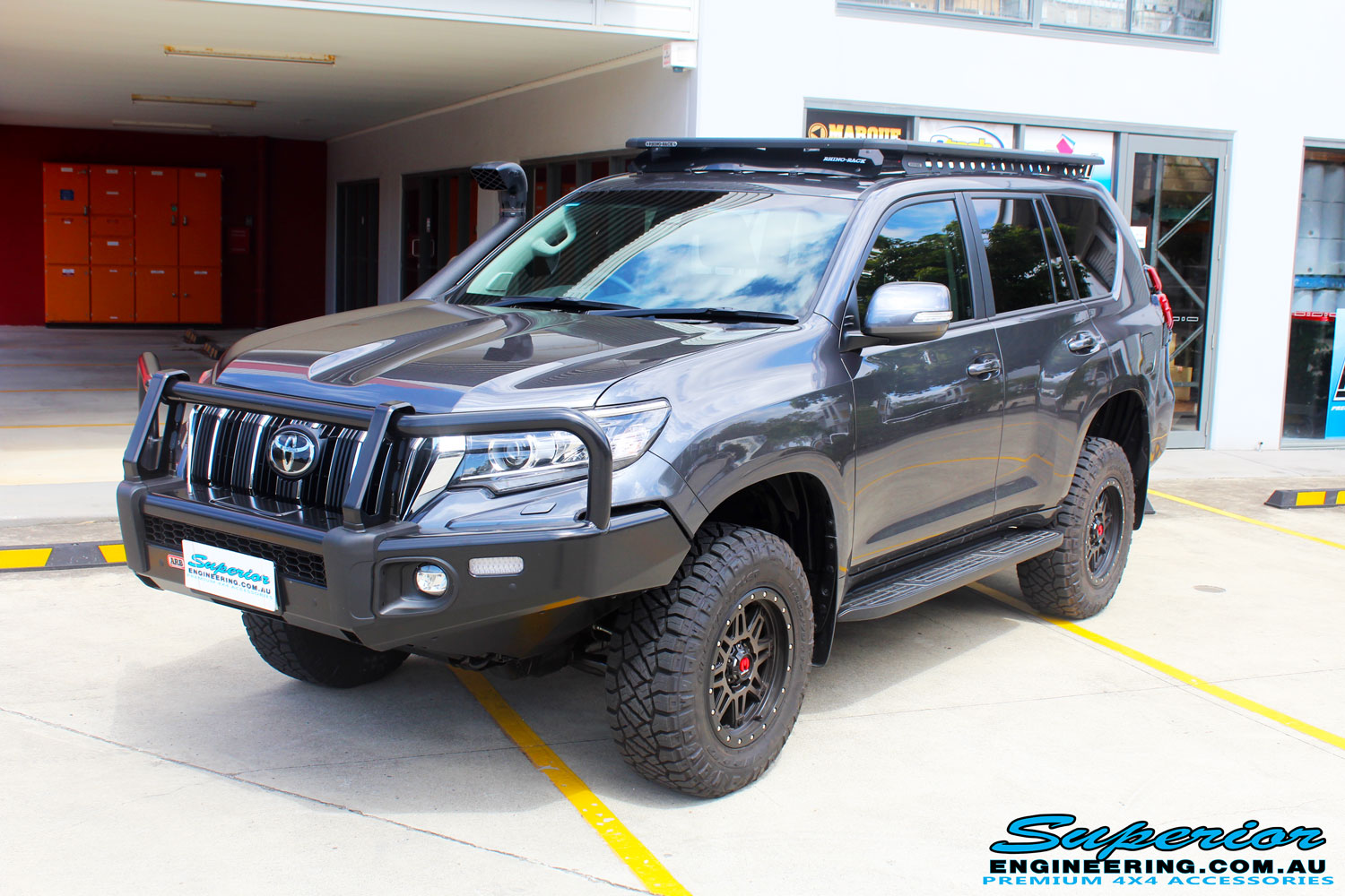 "Left front side view of a Toyota 150 Landcruiser Prado in Grey after fitment of a 2"" Inch Lift Kit"
