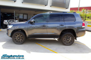 """Left side view of a Grey Toyota 200 Series Landcruiser after fitment of a Superior Remote Reservoir 2"""" Inch Lift Kit with King Springs & Airbag Man 2"""" Coil Air Helper Kit"""