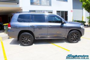 """Right side view of a Grey Toyota 200 Series Landcruiser before fitment of a Superior Remote Reservoir 2"""" Inch Lift Kit with King Springs & Airbag Man 2"""" Coil Air Helper Kit"""