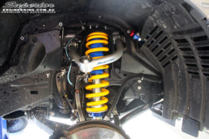 Front right inside guard view of the fitted Superior Remote Reservoir Strut with Superior Upper Control Arm & King Coil Spring