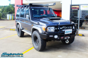 "Right front side view of a Toyota 76 Series Landcruiser Wagon in Grey before fitment of a EFS 2"" Lift Kit"