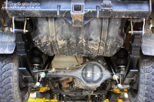 """Mid rear underbody view of the fitted EFS 2"""" Rear Shocks with EFS Leaf Springs"""