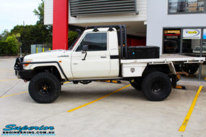 """Right side view of a 79 Series Landcruiser Single Cab after fitting a 4"""" Inch Superior Remote Reservoir Superflex Kit"""