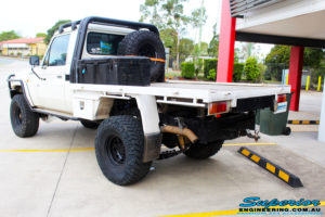 """Rear right side view of a 79 Series Landcruiser Single Cab after fitting a 4"""" Inch Superior Remote Reservoir Superflex Kit"""