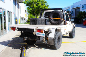 """Rear right side view of a 79 Series Landcruiser Single Cab before fitting a 4"""" Inch Superior Remote Reservoir Superflex Kit"""