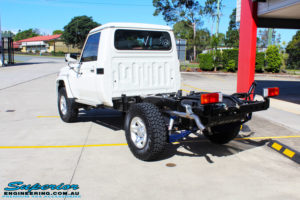 Rear left side view of a Toyota Landcruiser 79 Series after fitment of a Lovells GVM Upgrade