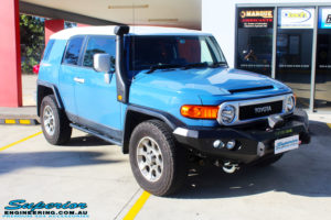 """Right front side view of a Toyota FJ Cruiser in Blue before fitment of a 2"""" Inch Lift Kit"""