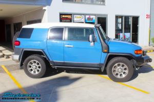 """Right side view of a Toyota FJ Cruiser in Blue before fitment of a 2"""" Inch Lift Kit"""