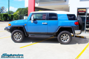 """Left side view of a Toyota FJ Cruiser in Blue before fitment of a 2"""" Inch Lift Kit"""