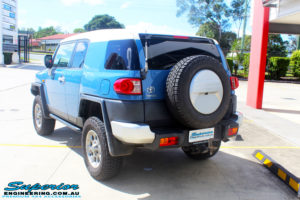"""Rear left view of a Toyota FJ Cruiser in Blue before fitment of a 2"""" Inch Lift Kit"""