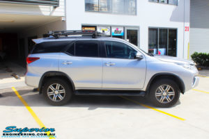 """Right side view of a Toyota Fortuner Wagon in Silver before fitment of a Fox 2.0 Performance Series IFP 2"""" Inch Lift Kit with Airbag Man Coil Helper Air Kit"""