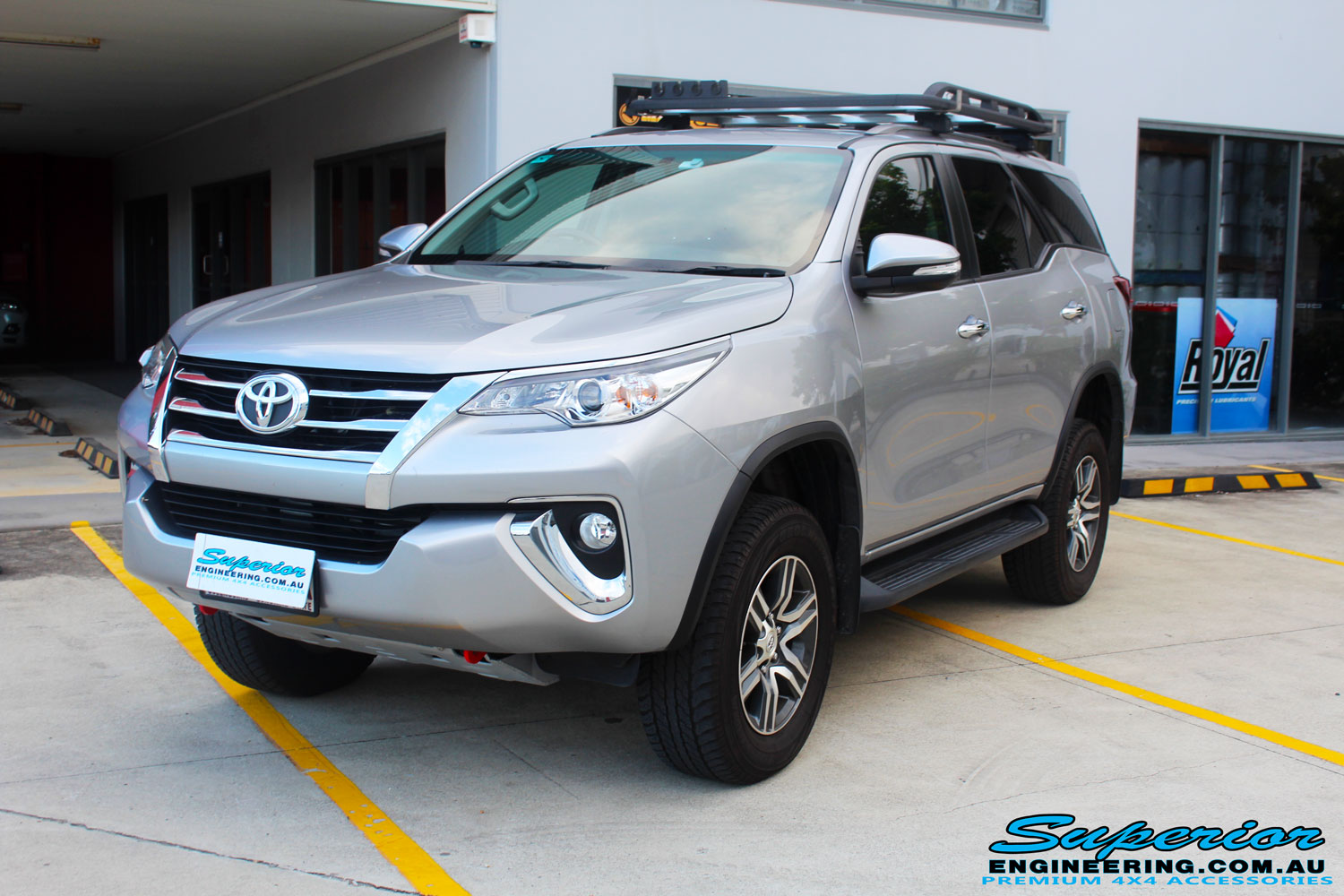 "Left front side view of a Toyota Fortuner Wagon in Silver after fitment of a Fox 2.0 Performance Series IFP 2"" Inch Lift Kit with Airbag Man Coil Helper Air Kit"