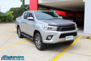 """Right front side view of a Toyota Revo Hilux Dual Cab in Silver before fitment of a 3"""" Inch Lift Kit with King Coil Springs, Superior Billet Alloy Upper Control Arms and Body Lift Kit"""