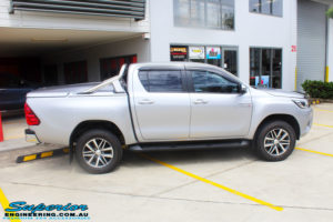 """Right side view of a Toyota Revo Hilux Dual Cab in Silver before fitment of a 3"""" Inch Lift Kit with King Coil Springs, Superior Billet Alloy Upper Control Arms and Body Lift Kit"""