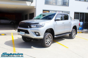"""Left front side view of a Toyota Revo Hilux Dual Cab in Silver after fitment of a 3"""" Inch Lift Kit with King Coil Springs, Superior Billet Alloy Upper Control Arms and Body Lift Kit"""