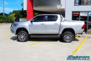 """Left side view of a Toyota Revo Hilux Dual Cab in Silver after fitment of a 3"""" Inch Lift Kit with King Coil Springs, Superior Billet Alloy Upper Control Arms and Body Lift Kit"""