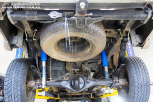 """Rear mid underbody shot of the fitted Superior 3"""" Nitrogen Filled Gas Rear Shocks + Leaf Springs with U-Bolt Kit & Greaseable Shackles"""