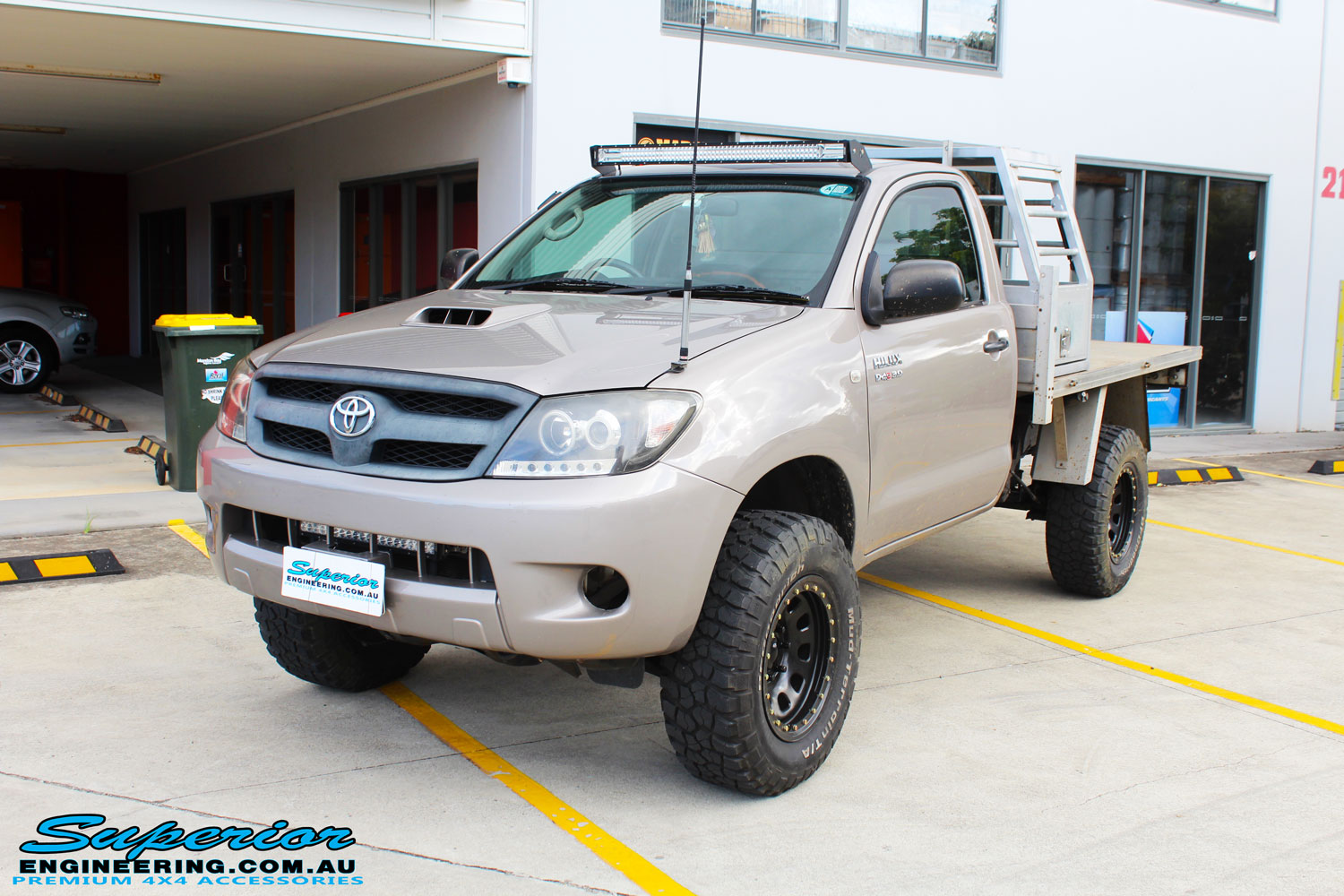 "Right front side view of a Toyota Vigo Hilux Single Cab in Grey after fitment of a Superior Nitro Gas 2"" Inch Lift Kit with King Coil Springs"