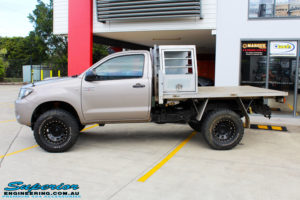 """Right side view of a Toyota Vigo Hilux Single Cab in Grey after fitment of a Superior Nitro Gas 2"""" Inch Lift Kit with King Coil Springs"""
